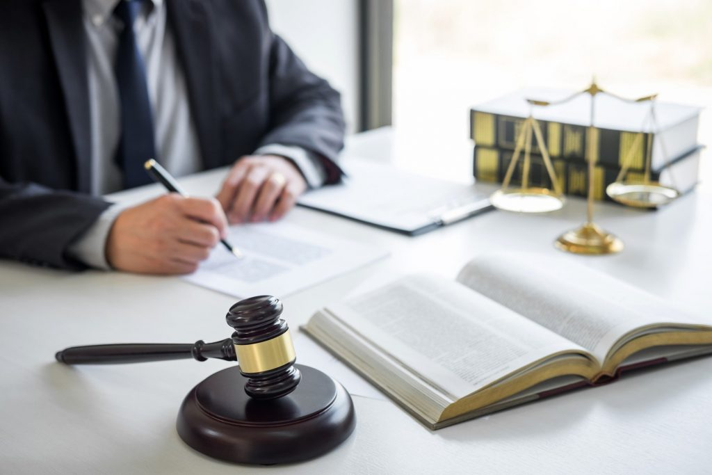 judge gavel with justice lawyers counselor in suit or lawyer working on a documents in courtroom t20 pR128d
